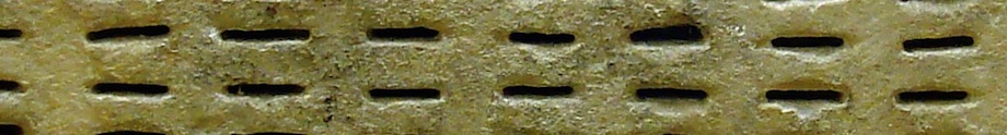 Particular of a photo (Ostracism holes)